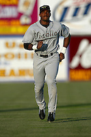 Tony Miller of the Visalia Oaks runs in the outfield before a game against the Lancaster JetHawks at The Hanger on May 20, 2003 in Lancaster, California. (Larry Goren/Four Seam Images)