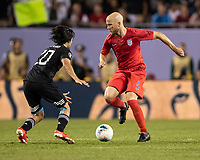 CHICAGO, IL - JULY 7: Rodolfo Pizarro #20 challenges Michael Bradley #4 during a game between Mexico and USMNT at Soldiers Field on July 7, 2019 in Chicago, Illinois.