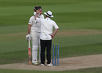 Rikki Clarke of Surrey receives a helping hand from the umpire as he appears to have something in his eye during Surrey CCC vs Somerset CCC, LV Insurance County Championship Group 2 Cricket at the Kia Oval on 13th July 2021