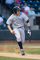 Hunter Dozier (18) of the Wilmington Blue Rocks hustles down the first base line against the Winston-Salem Dash at BB&T Ballpark on April 3, 2014 in Winston-Salem, North Carolina.  The Blue Rocks defeated the Dash 3-1.  (Brian Westerholt/Four Seam Images)