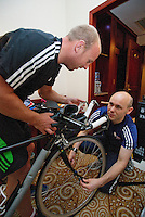 08 SEP 2011 - BEIJING, CHN - Iain Dawson (right) prepares his tandem with guide Liam Gentry at their hotel before the ITU World Paratriathlon Championships (PHOTO (C) NIGEL FARROW)