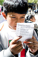 Jaime Chamol reviews several protest chants during a rally at  Roosevelt Park, one of several meeting spots for protesters of United States immigration policy in New York City on May 1, 2006.