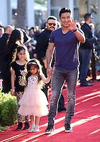 Mario Lopez + daughter Gia @ the premiere of 'The Jungle Book' held @ El Capitan theatre.<br /> April 4, 2016