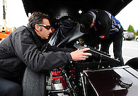 Oct. 2, 2011; Mohnton, PA, USA: NHRA crew chief Aaron Brooks makes an adjustment to the car of funny car driver Leah Pruett during the Auto Plus Nationals at Maple Grove Raceway. Mandatory Credit: Mark J. Rebilas-