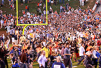Oct. 15, 2011-Charlottesville, VA.-USA-  Virginia Cavaliers fans storm the field during an ACC football game against the Georgia Tech at Scott Stadium. Virginia won 24-21. (Credit Image: © Andrew Shurtlef