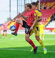 Lincoln City's Harry Anderson shields the ball from Oxford United's Josh Ruffels<br /> <br /> Photographer Chris Vaughan/CameraSport<br /> <br /> The EFL Sky Bet League One - Saturday 12th September 2020 - Lincoln City v Oxford United - LNER Stadium - Lincoln<br /> <br /> World Copyright © 2020 CameraSport. All rights reserved. 43 Linden Ave. Countesthorpe. Leicester. England. LE8 5PG - Tel: +44 (0) 116 277 4147 - admin@camerasport.com - www.camerasport.com - Lincoln City v Oxford United