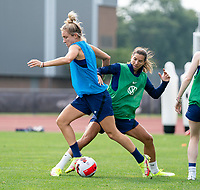 CLEVELAND, OH - SEPTEMBER 14: Kristie Mewis is defended by Tobin Heath of the United States during a training session at the training fields on September 14, 2021 in Cleveland, Ohio.