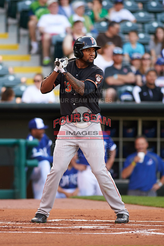 Fresno Grizzles outfielder Domingo Santana (13) at bat during a game against the Oklahoma City Dodgers on June 1, 2015 at Chickasaw Bricktown Ballpark in Oklahoma City, Oklahoma.  Fresno defeated Oklahoma City 14-1.  (Mike Janes/Four Seam Images)