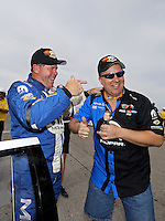 Apr. 6, 2013; Las Vegas, NV, USA: NHRA pro stock driver Allen Johnson celebrates with Vincent Jardine who paired with Allen Johnson winning a 2013 Toyota Tundra after Johnson won the K&N Horsepower Challenge during qualifying for the Summitracing.com Nationals at the Strip at Las Vegas Motor Speedway. Mandatory Credit: Mark J. Rebilas-