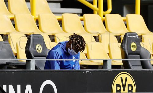 16th May 2020, Signal Iduna Park, Dortmund, Germany; Bundesliga football, Borussia Dortmund versus FC Schalke; Schalke 04 Jean-Clair Todibo sits in the stands with mask