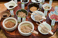 Flavoured dried whitebait is used to garnish rice and sald dishes in Japan. Here, samples are served to customers of Kyoto's Nishiki Market.
