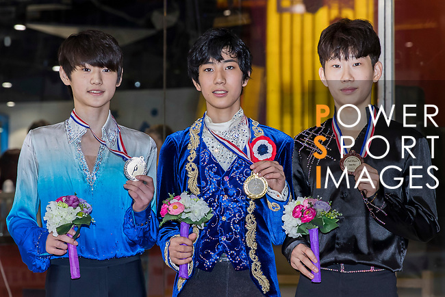 The winners of the Junior Men competition from left to right are, Silver medalist from Korea Sung Hoon Park, Gold metalist from Japan Sena Miyake, Bronze metalist from Korea Jae Seok Kyeong all stand together holding their medals, and pose for photo during the Asian Open Figure Skating Trophy 2017 at Mega Ice on 03 August, 2017 in Hong Kong, China. Photo by Yu Chun Christopher Wong / Power Sport Images