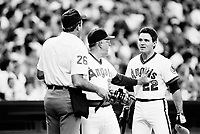 Dick Schofield of the California Angels is restrained by manager Cookie Rojas while arguing with a umpire during a 1988 season game at Anaheim Stadium,in Anaheim,California.(Larry Goren/Four Seam Images)