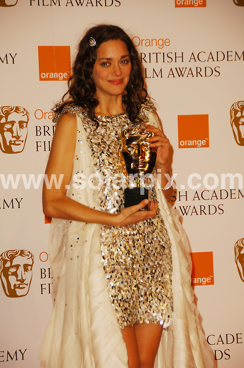 **ALL ROUND PICTURES FROM SOLARPIX.COM**.**WORLDWIDE SYNDICATION RIGHTS**.The Orange British Academy Film Awards.Royal Opera House, London, February 10th 2008   ..This pic: Marion Coutillard..JOB REF: 5750 MSR    DATE: 08_02_2008.**MUST CREDIT SOLARPIX.COM OR DOUBLE FEE WILL BE CHARGED* *UNDER NO CIRCUMSTANCES IS THIS IMAGE TO BE REPRODUCED FOR ANY ONLINE EDITION WITHOUT PRIOR PERMISSION*