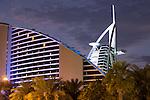 United Arab Emirates, Dubai: The Jumeirah Beach Hotel and Burj al Arab at dusk