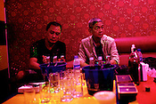 A family seen at a Karaoke Bar in Manila, Philippines. Photo: Sanjit Das