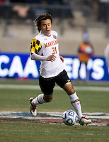 Tsubasa Endoh (31) of Maryland brings the ball upfield during the NCAA Men's College Cup semifinals at PPL Park in Chester, PA.  Maryland defeated Virginia, 2-1.