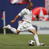 July 24, 2005: East Rutherford, NJ, USA:  USMNT midfielder Chris Armas (14) pushes the ball forward during the CONCACAF Gold Cup Finals at Giants Stadium.  The USMNT won 3-1 on penalty kicks.
