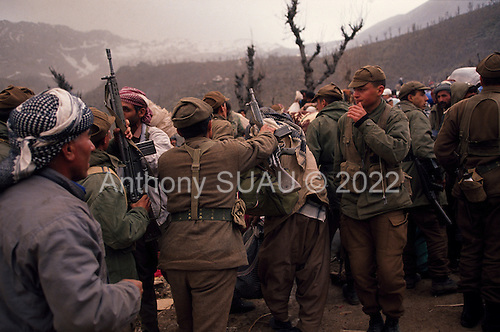 Isikveren, Turkey.April 16, 1991..Kurdish families, being detained and sometimes aggressed by well armed Turkish soldiers, wait to be transported from a mountain top refugee camp. The camp became home to an estimated 300,000 refugees when they fled Saddam Hussein's post Gulf war persecution...In the wake of the 1991 Persian Gulf War rebellions in Southern and Northern Iraq occurred. The uprising in the Kurdish areas of Northern Iraq broke out in March, sparked by demoralized Iraqi Army troops returning from it's defeat against United States lead coalition forces in southern Iraq and Kuwait. Although they presented a threat to Iraqi President Saddam Hussein?s regime, his Iraqi Republican Guard suppressed the rebellion with massive force, as the expected US intervention never materialized. ..The faltering rebellion fueled a terrified mass exodus. The U.N. High Commissioner for Refugees called it the largest in its 40?year history. During March and early April, nearly two million of Iraqis escaped from strife-torn cities to the mountains along the northern borders and into Turkey and Iran. Their exodus was sudden and chaotic, with thousands fleeing on foot, on donkeys, or crammed onto open-backed trucks and tractors. Thousands, many of them children, died or suffered injury along the way, primarily from adverse weather, unhygienic conditions and insufficient food and medical care. Some were killed by army helicopters, which deliberately strafed columns of fleeing civilians. Others were injured when they stepped on land mines planted by Iraqi troops near the Iran border during the war. Greenpeace has estimated that at one point in 1991, an estimated 2,000 Kurds were dying every day..