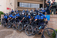 AUSTIN, TEXAS - MAY 30, Austin Police officers close ranks and form a barricade using bicycles during a Black Lives Matter rally at APD Headquarters on May 30, 2020 in Austin, Texas.<br />
