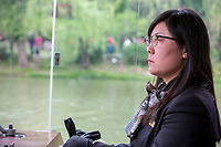 Yangzhou, Jiangsu, China.  Pleasure Boat Pilot, Slender West Lake Park.