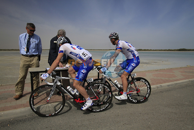 FDJ-BigMat team riders Mickael Delage and Matthieu Ladagnous (FRA) sign on before the start of Stage 4 of the 2012 Tour of Qatar from Al Thakhira to Madinat Al Shamal, Qatar. 8th February 2012.<br /> (Photo Eoin Clarke/Newsfile)