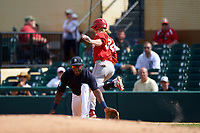 Detroit Tigers first baseman John Mayberry Jr. (64) picks a throw as Mitch Reeves (34) runs through the bag during an exhibition game against the Florida Southern Moccasins on February 29, 2016 at Joker Marchant Stadium in Lakeland, Florida.  Detroit defeated Florida Southern 7-2.  (Mike Janes/Four Seam Images)