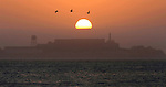 The sun rises over the Alcatraz Island in San Francisco, California.