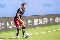 LAKE BUENA VISTA, FL - JULY 13: Julian Gressel #31 of DC United dribbles the ball during a game between D.C. United and Toronto FC at Wide World of Sports on July 13, 2020 in Lake Buena Vista, Florida.