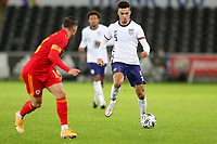 SWANSEA, WALES - NOVEMBER 12: Antonee Robinson #5 of the United States  moving forward with the ball during a game between Wales and USMNT at Liberty Stadium on November 12, 2020 in Swansea, Wales.
