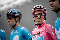 Maglia Rosa / overall leader & birthday boy Richard Carapaz (ECU/Movistar) on the start podium<br /> <br /> Stage 17: Commezzadura (Val di Sole) to Anterselva/Antholz (181km)<br /> 102nd Giro d'Italia 2019<br /> <br /> ©kramon