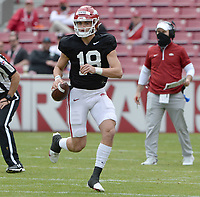 Arkansas quarterback Kade Renfro (18) rolls out to pass the ball Saturday, April 3, 2021, during a scrimmage at Razorback Stadium in Fayetteville. Visit nwaonline.com/210404Daily/ for today's photo gallery. <br /> (NWA Democrat-Gazette/Andy Shupe)