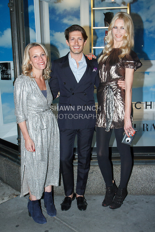 Chief Merchant of Saks Fifth Avenue Tracy Margolies (left) designer Edgardo Osorio and supermodel Claudia Schiffer, arrive at the Claudia Schiffer for Aquazzura launch event at Saks Fifth Avenue, at 611 Fifth Avenue, in New York City on October 17, 2017.