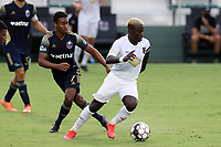 CARY, NC - AUGUST 01: Anderson Asiedu #6 turns away from Pecka #7 during a game between Birmingham Legion FC and North Carolina FC at Sahlen's Stadium at WakeMed Soccer Park on August 01, 2020 in Cary, North Carolina.