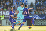 Luis Alberto Suarez Diaz of FC Barcelona (C) fights for the ball with Ruben Salvador Perez del Marmol of CD Leganes (L) and Ezequiel Matias Munoz of CD Leganes (R) during the La Liga 2017-18 match between CD Leganes vs FC Barcelona at Estadio Municipal Butarque on November 18 2017 in Leganes, Spain. Photo by Diego Gonzalez / Power Sport Images