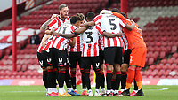 Pontus Jansson of Brentford gives some last minute instructions to his team while in the huddle ahead of kick-off during Brentford vs Preston North End, Sky Bet EFL Championship Football at Griffin Park on 15th July 2020