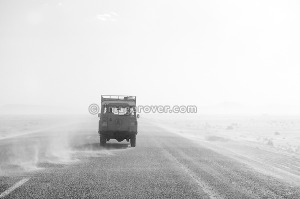Africa, Tunisia, between Gafsa and Kebili. Historic Land Rover Series 3 driving through a sand storm across the Chott El Jerid. --- No releases available, but releases may not be needed for certain uses. Automotive trademarks are the property of the trademark holder, authorization may be needed for some uses.  --- Info: Image belongs to a series of photographs taken on a journey to southern Tunisia in North Africa in October 2010. The trip was undertaken by 10 people driving 5 historic Series Land Rover vehicles from the 1960's and 1970's. Most of the journey's time was spent in the Sahara desert, especially in the area around Douz, Tembaine, Ksar Ghilane on the eastern edge of the Grand Erg Oriental.