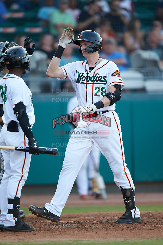 Sam Huff (28) of the Down East Wood Ducks high fives teammate Julio Pablo Martinez (23) after hitting a home run against the Winston-Salem Dash at Grainger Stadium Field on May 17, 2019 in Kinston, North Carolina. The Dash defeated the Wood Ducks 8-2. (Brian Westerholt/Four Seam Images)