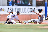 Asheville Tourists third baseman Scotty Burcham (10) applies the tag to a hard sliding Mandy Alvarez (2) during a game against the Charleston RiverDogs at McCormick Field on July 10, 2016 in Asheville, North Carolina. The Tourists defeated the RiverDogs 4-2. (Tony Farlow/Four Seam Images)