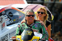 Oct 3, 2014; Mohnton, PA, USA; NHRA funny car driver John Force (left) talks with daughter Courtney Force during qualifying for the NHRA Nationals at Maple Grove Raceway. Mandatory Credit: Mark J. Rebilas-USA TODAY Sports
