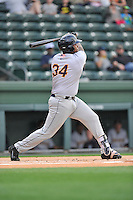 First baseman Chris Gittens (34) of the Charleston RiverDogs bats in a game against the Greenville Drive on Tuesday May 17, 2016, at Fluor Field at the West End in Greenville, South Carolina. Greenville won, 4-2. (Tom Priddy/Four Seam Images)