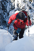 A winter hiker ascending the Carter - Moriah Trail on his way to Mount Moriah in the White Mountains, New Hampshire during the winter months