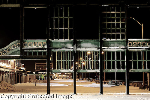 A view from old Asbury Park, New Jersey Casino taken on a cold winter's night facing the historic Convention Hall and Paramount Theatre.  The Casino is currently being preserved.  The board walk is a very popular attraction especially in the warmer weather
