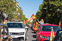 MADRID, SPAIN - OCTOBER 12: A woman waves a Spanish flag during a protest against the Government summoned by VOX, Spanish far-right party and third biggest party in the Parliament, on 12 October 2020, in Madrid, Spain. The demonstration coincides with the National Day in Spain after the Government declared state of alarm in the Madrid region on previous Friday to slow down the high Covid-19 cases in some municipalities of this region. (Photo by Sergio Belena/VIEWpress via Getty Images).