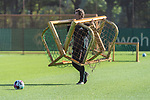 13.10.2020, Trainingsgelaende am wohninvest WESERSTADION - Platz 12, Bremen, GER, 1.FBL, Werder Bremen Training<br /> <br /> <br /> <br /> Günther / Guenther Stoxreiter (Athletik-Trainer Werder Bremen) bringt die Trainingstore vom Platz<br /> <br /> Querformat<br /> <br /> Foto © nordphoto / Kokenge