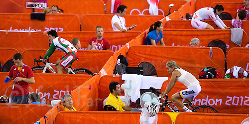 06 AUG 2012 - LONDON, GBR - Competitors prepare for their races during the London 2012 Olympic Games track cycling at the Olympic Park Velodrome in Stratford, London, Great Britain .(PHOTO (C) 2012 NIGEL FARROW)