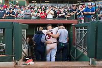 Peoria Javelinas first baseman Braxton Davidson (34), of the Atlanta Braves organization, is carried off the field while being applauded by the crowd after hitting a walk-off home run to win the Arizona Fall League Championship Game against the Salt River Rafters at Scottsdale Stadium on November 17, 2018 in Scottsdale, Arizona. Peoria defeated Salt River 3-2 in 10 innings. Davidson broke his left foot while rounding second base. (Zachary Lucy/Four Seam Images)