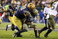 Philadelphia, PA - December 14, 2019:    Navy Midshipmen defensive lineman Jackson Pittman (99) tackles Army Black Knights quarterback Christian Anderson (13) during the 120th game between Army vs Navy at Lincoln Financial Field in Philadelphia, PA. (Photo by Elliott Brown/Media Images International)