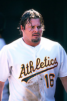 OAKLAND, CA - Jason Giambi of the Oakland Athletics walks in the dugout during a game at the Oakland Coliseum in Oakland, California in 2000. Photo by Brad Mangin