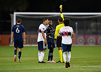 LAKE BUENA VISTA, FL - JULY 26: Referee Victor Rivas issues a yellow card to Gadi Kinda of Sporting KC during a game between Vancouver Whitecaps and Sporting Kansas City at ESPN Wide World of Sports on July 26, 2020 in Lake Buena Vista, Florida.